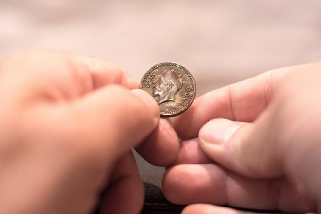 Man about to flip a coin