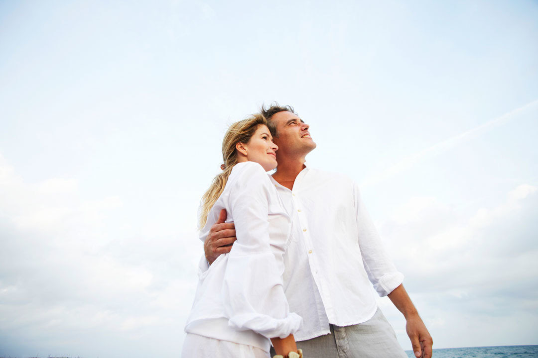 Happy couple on the ocean