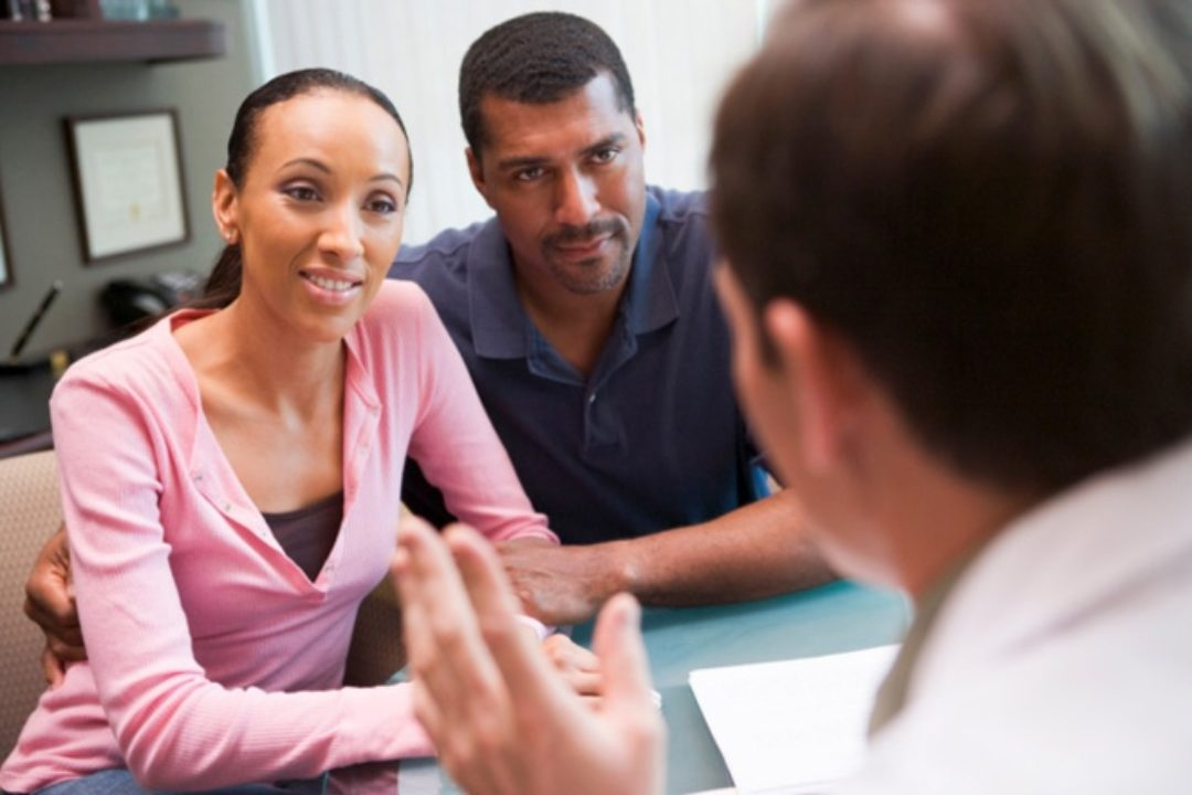 Couple having conversation with doctor