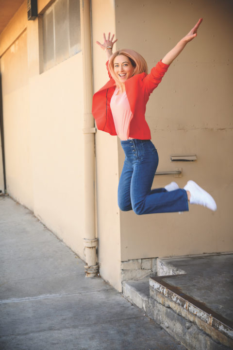 Kelly McGonigal jumping for joy