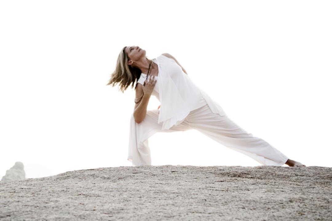 Laura Plumb in yoga pose