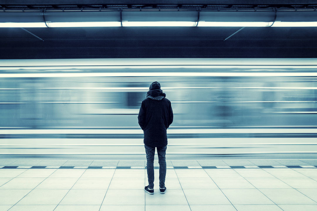 Man alone at subway station