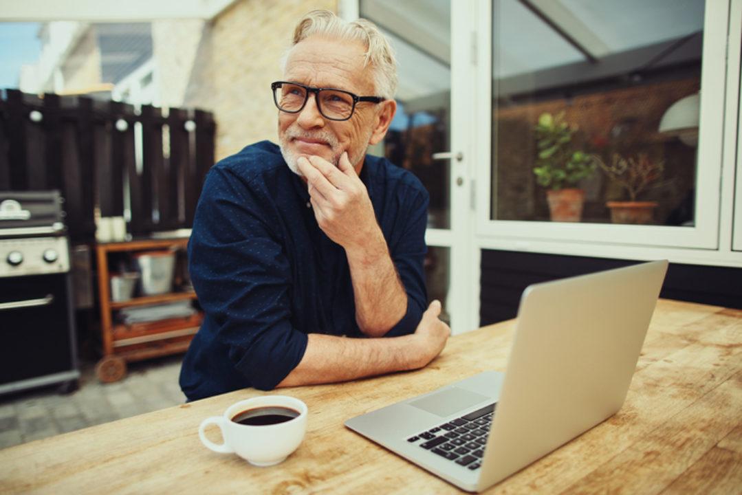 Senior man at computer