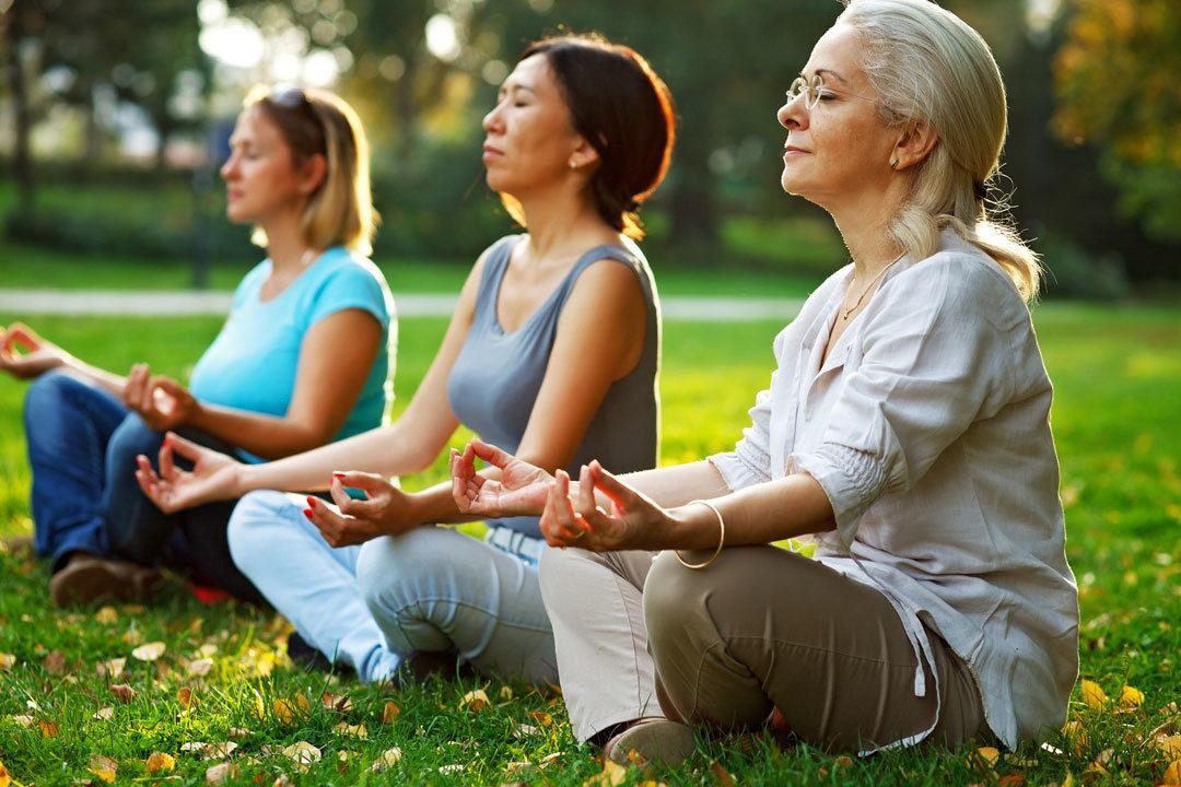 Woman practicing meditation outside