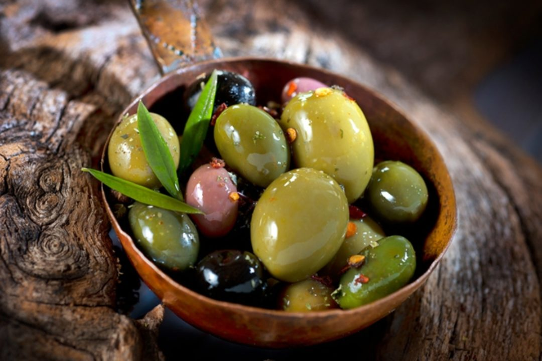 Assortment of olives in wood bowl