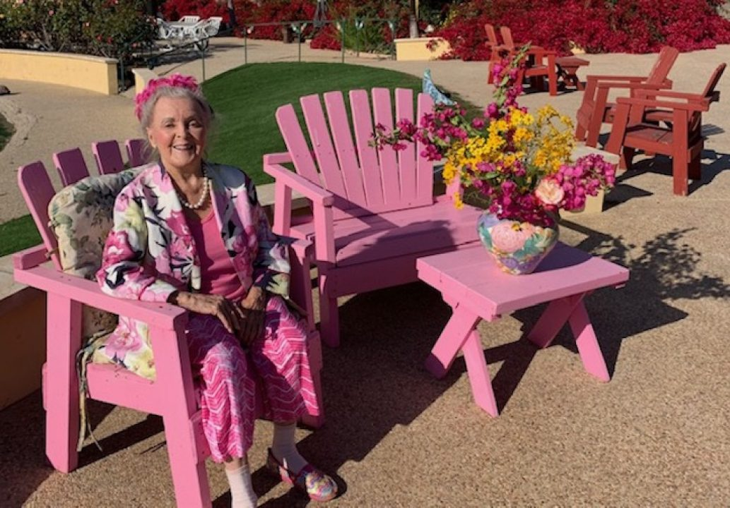 Patricia Bragg sitting in chair outdoors on patio
