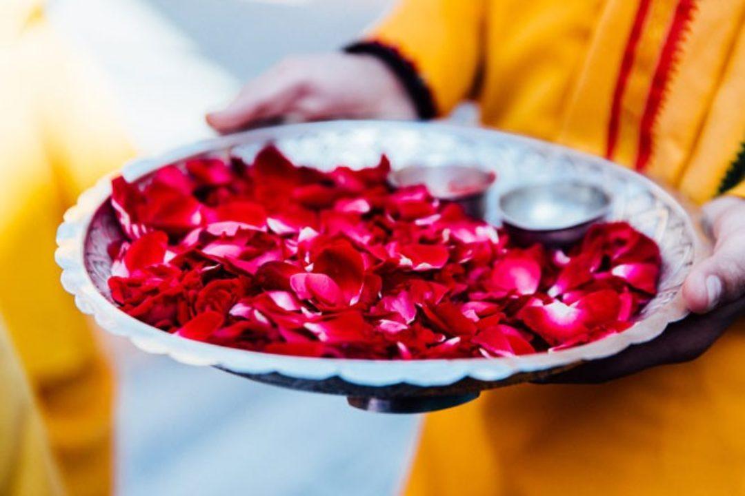 Ashram boy with tray of rose petals
