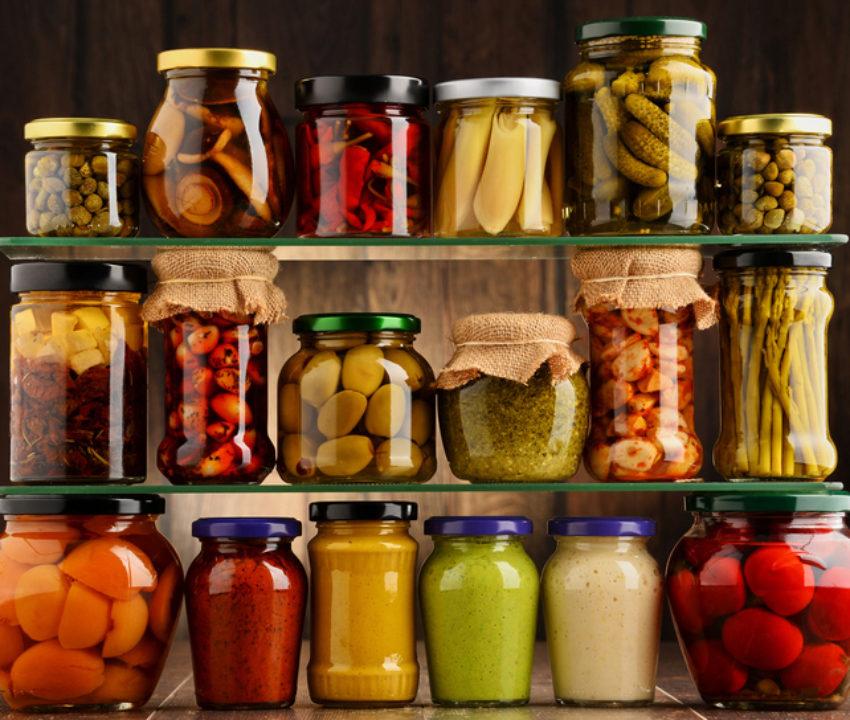 Variety of pickled vegetables in jars