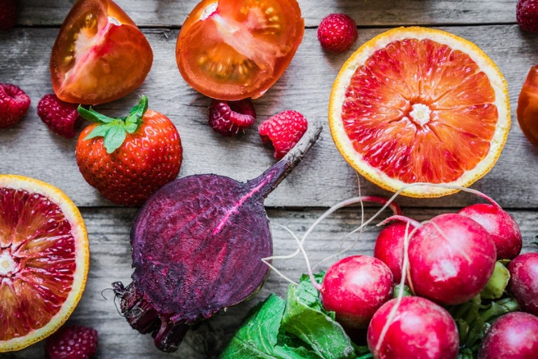 Red foods on wooden table