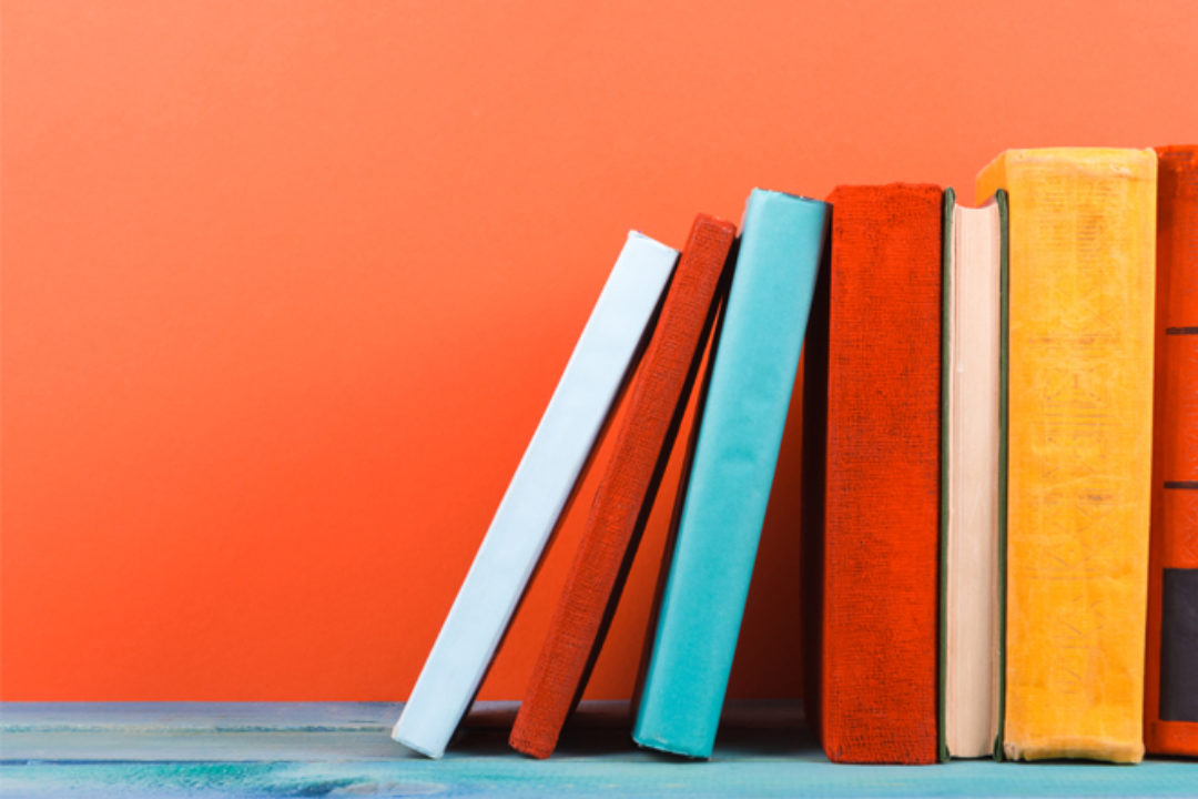 Bright books on orange wall