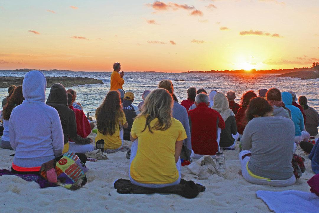 Retreat participants on beach at Sivananda Ashram Yoga Retreat Bahamas