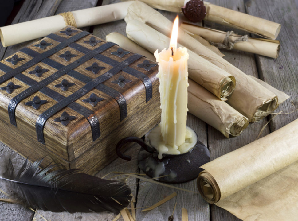 Box with candle and scrolls