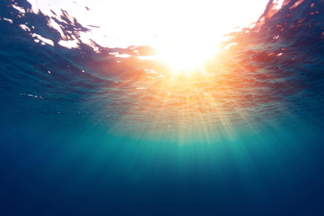 Sun shining through the  surface of the sea