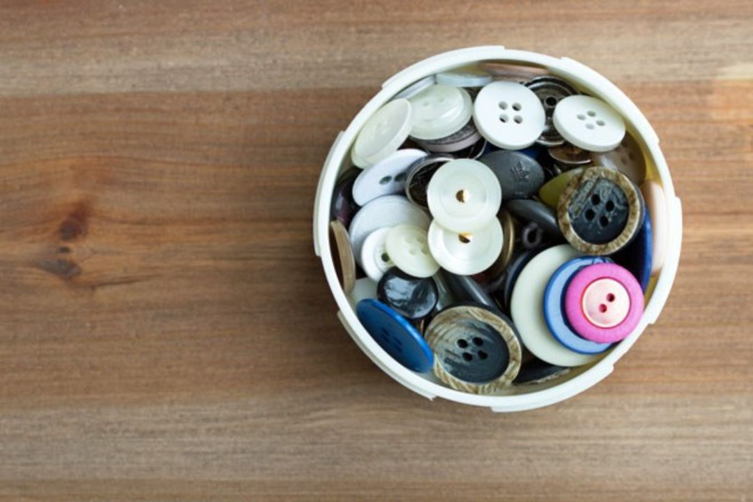 Assortment of buttons on wood