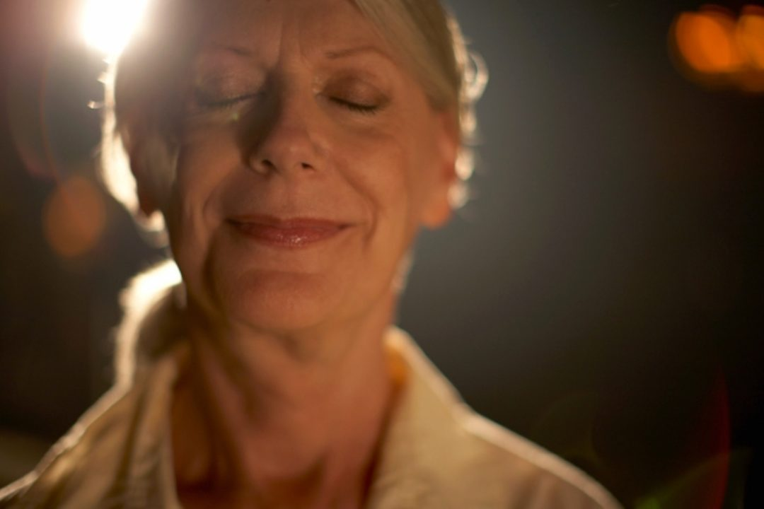 Woman smiling with closed eyes