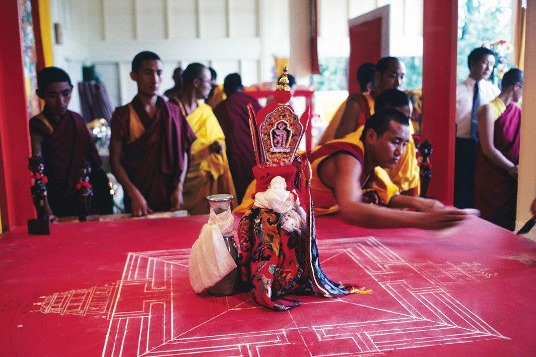 Tibetan Buddhist monks after mandala was destroyed