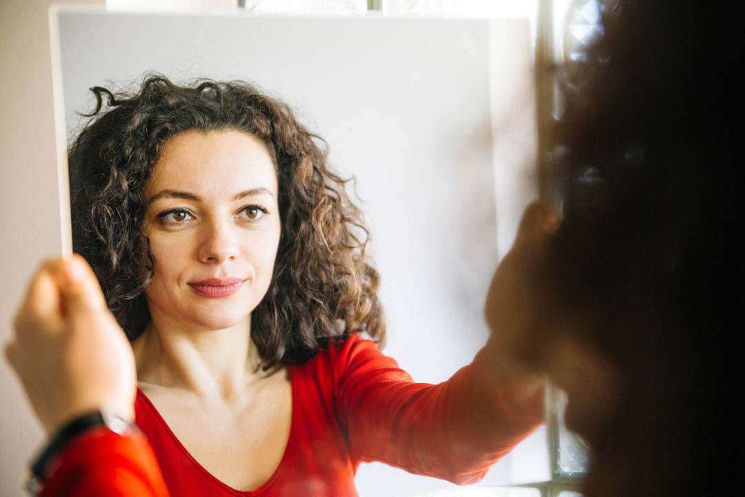 Woman talking to herself in mirror