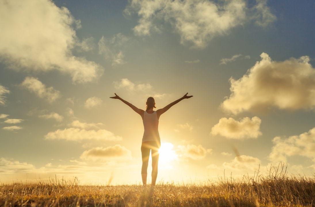 Happy person in sunshine