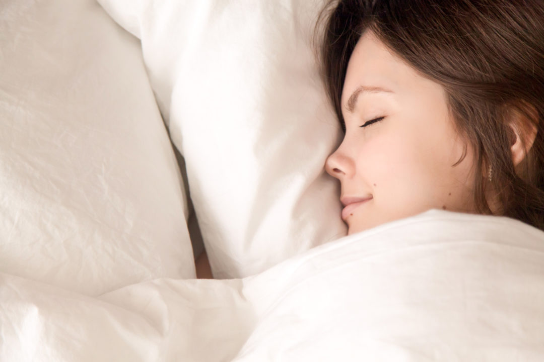 woman sleeping happy