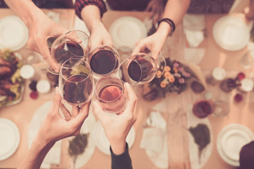Group toasting alcoholic drinks