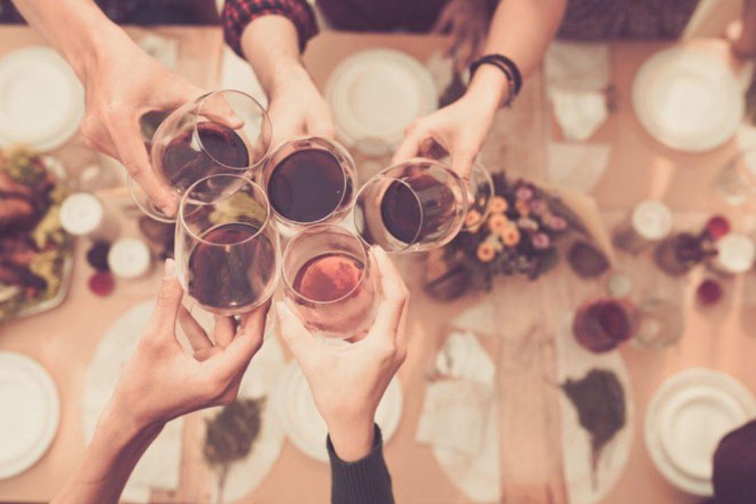 Group toasting alcoholic drinks