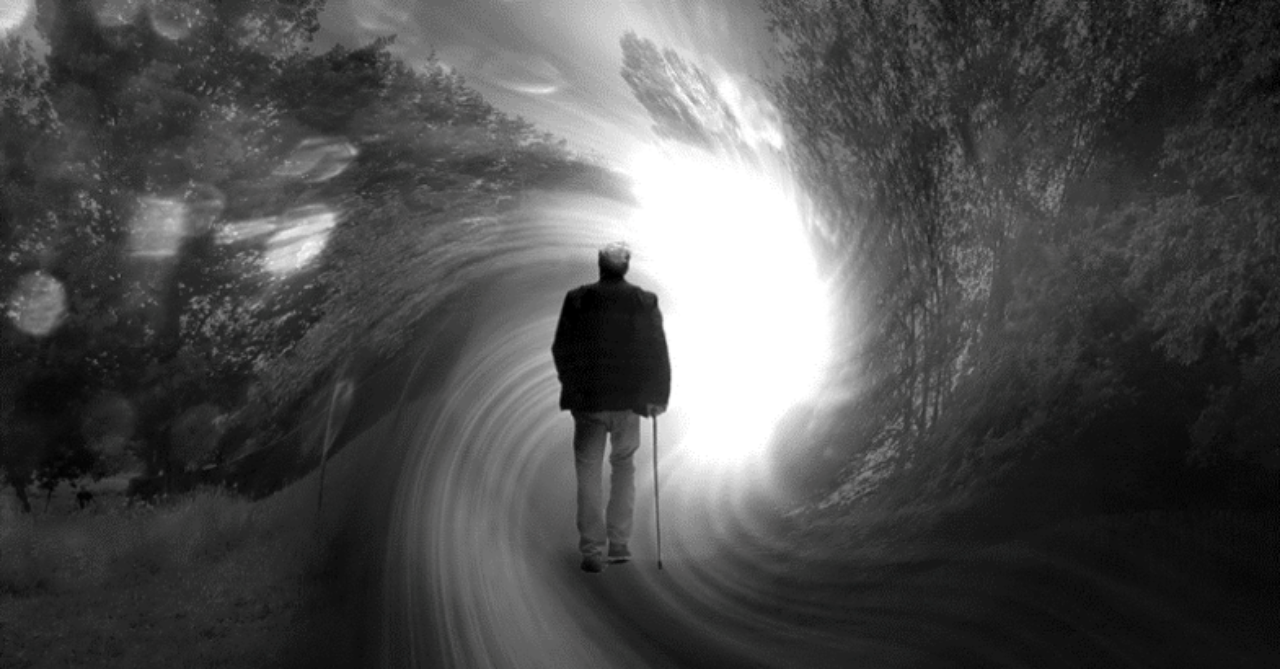 A man enters a tunnel, perhaps an after-death experience.