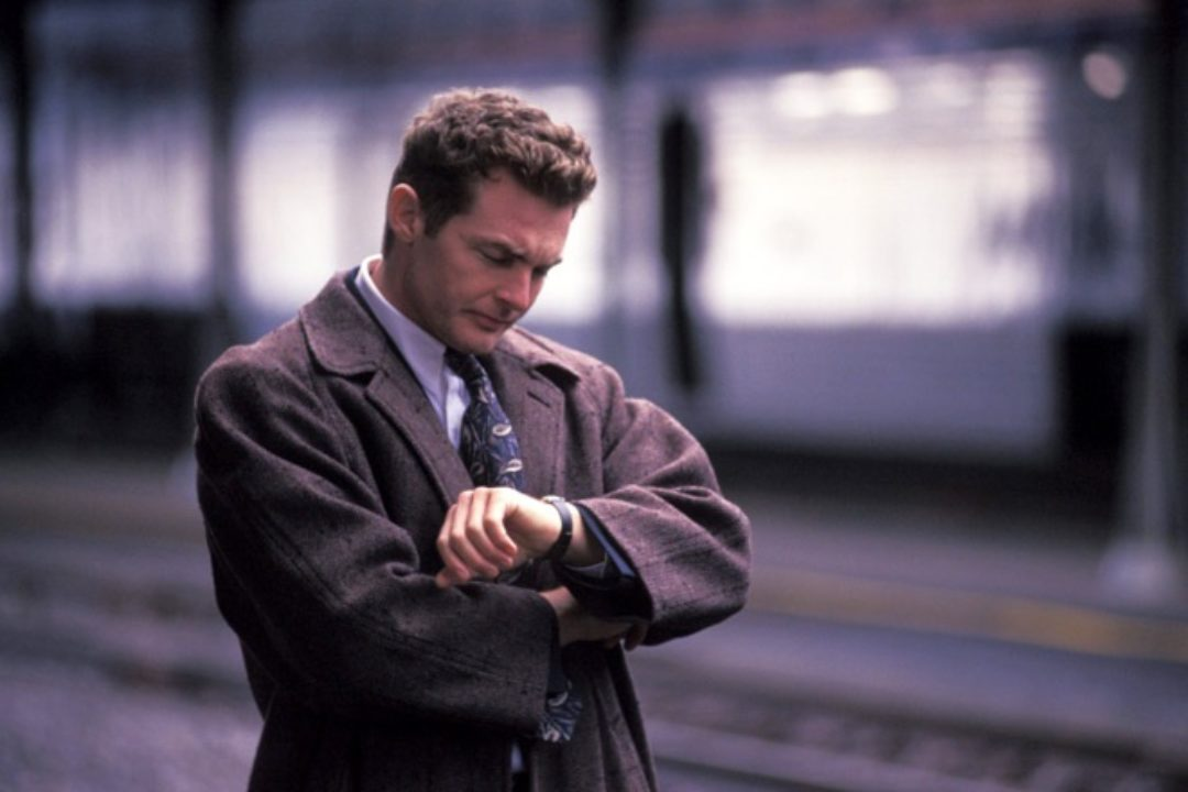 Businessman disappointed at train station