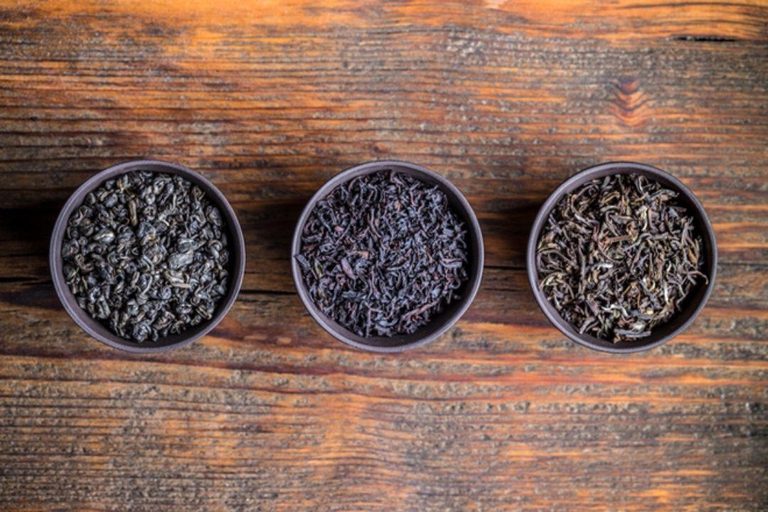 Dried tea leaves on wood surface