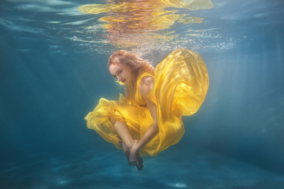 floating under water in a spiritual ritual