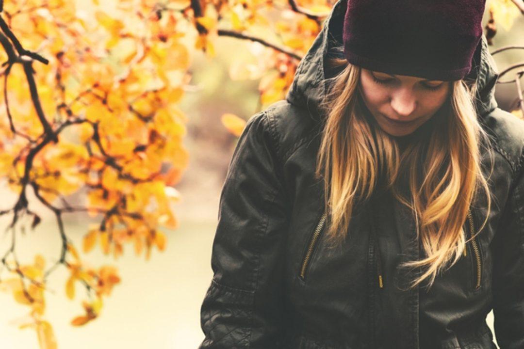 Sad woman in fall
