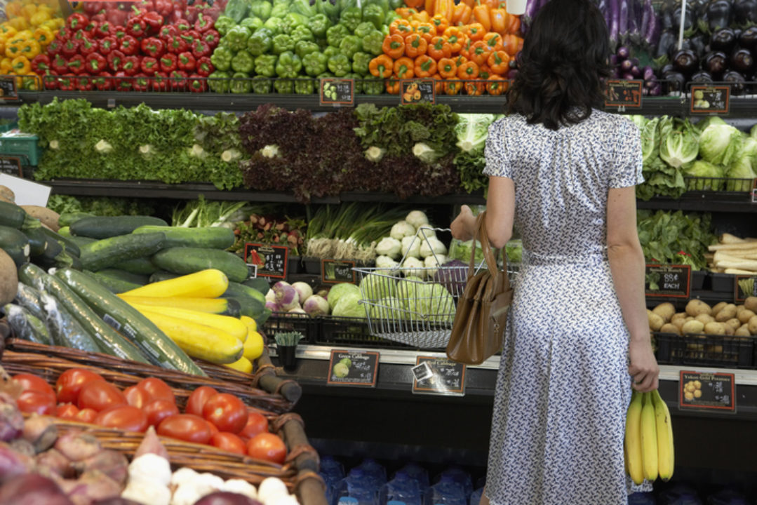 Woman standing in the produce aisle