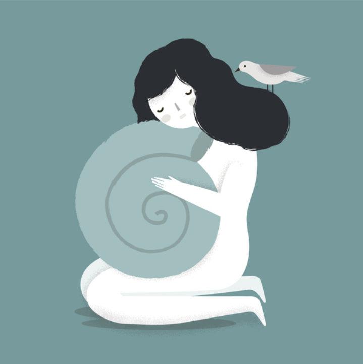 Woman holding seashell