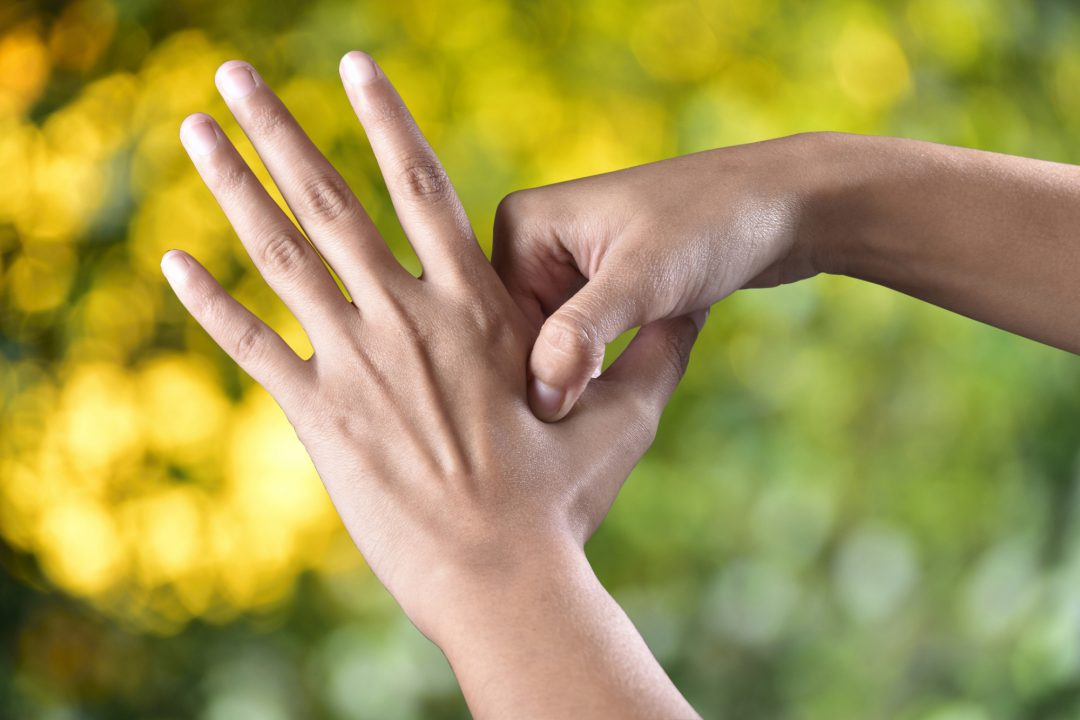 Acupressure being used on hand to treat emotional blocks and restore emotional balance.