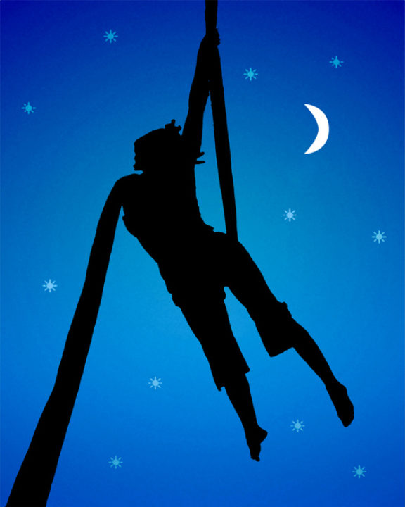 Silhouette of a woman doing fabric acrobats over moonscape background