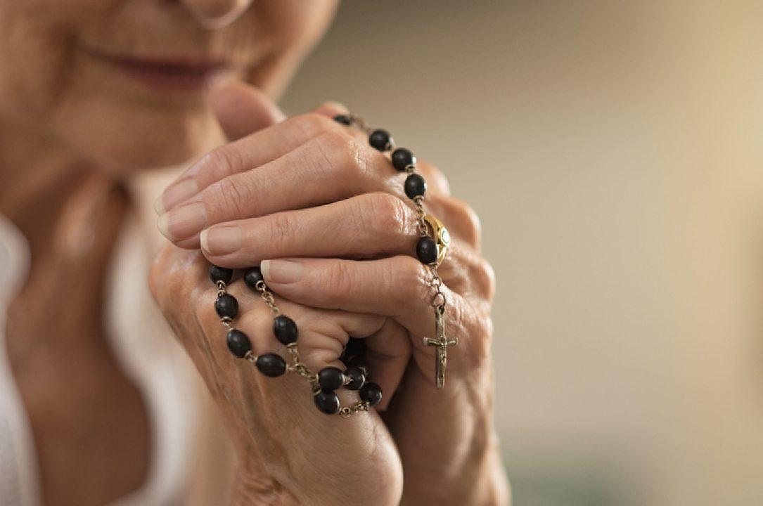 woman praying animal rosary prayer