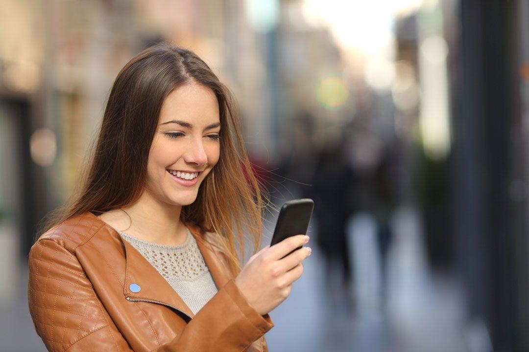 woman happy looking at phone