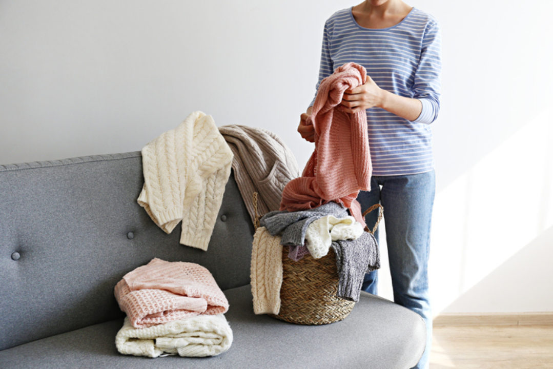 Woman sorting her sweaters