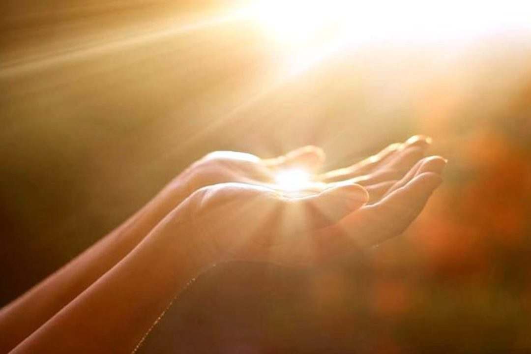 woman's hands holding light