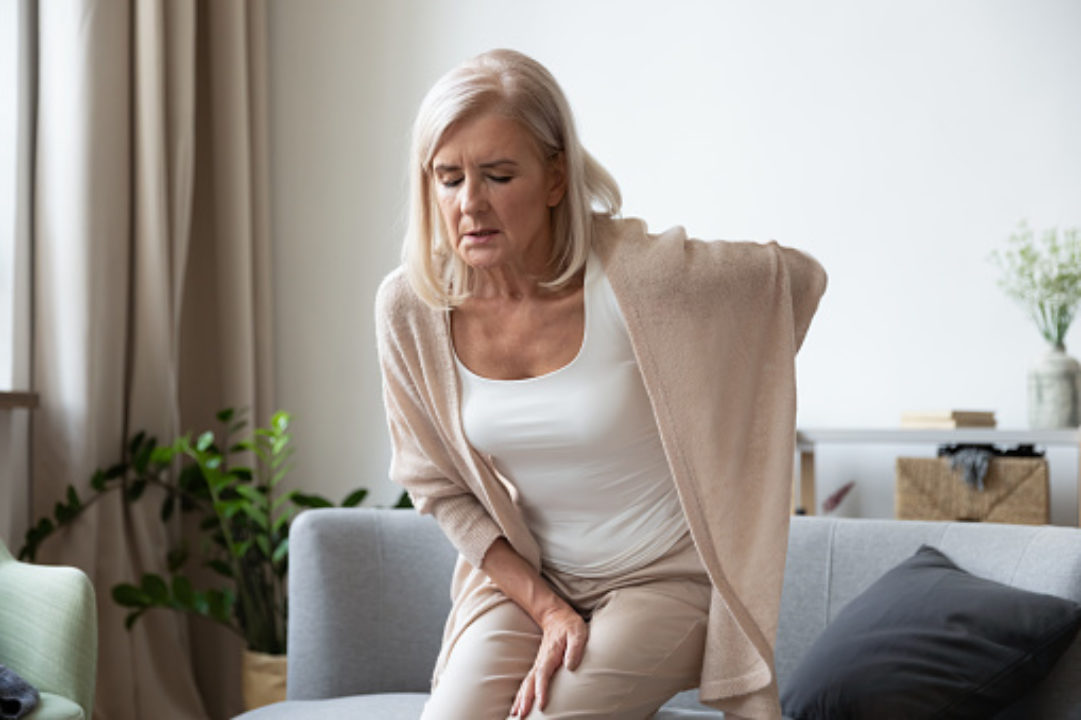 Woman in her 60s suffers from chronic back pain.