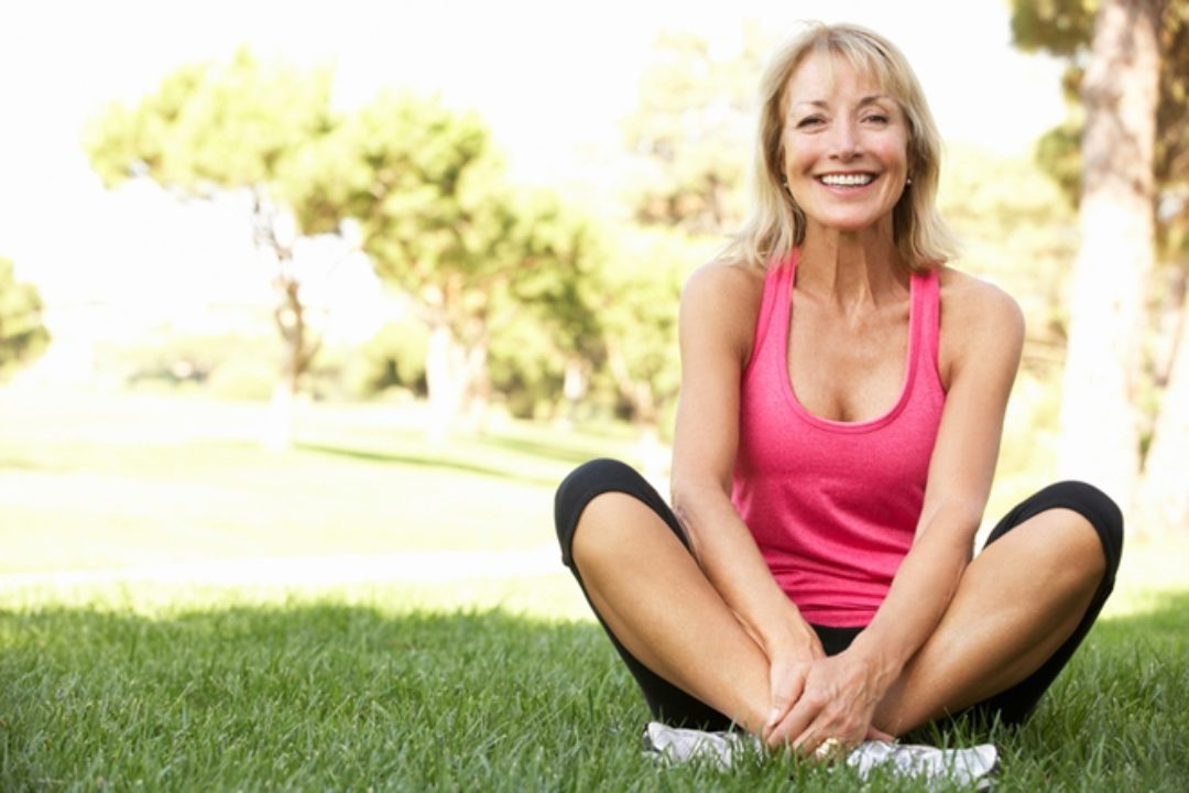 Woman in park exercising