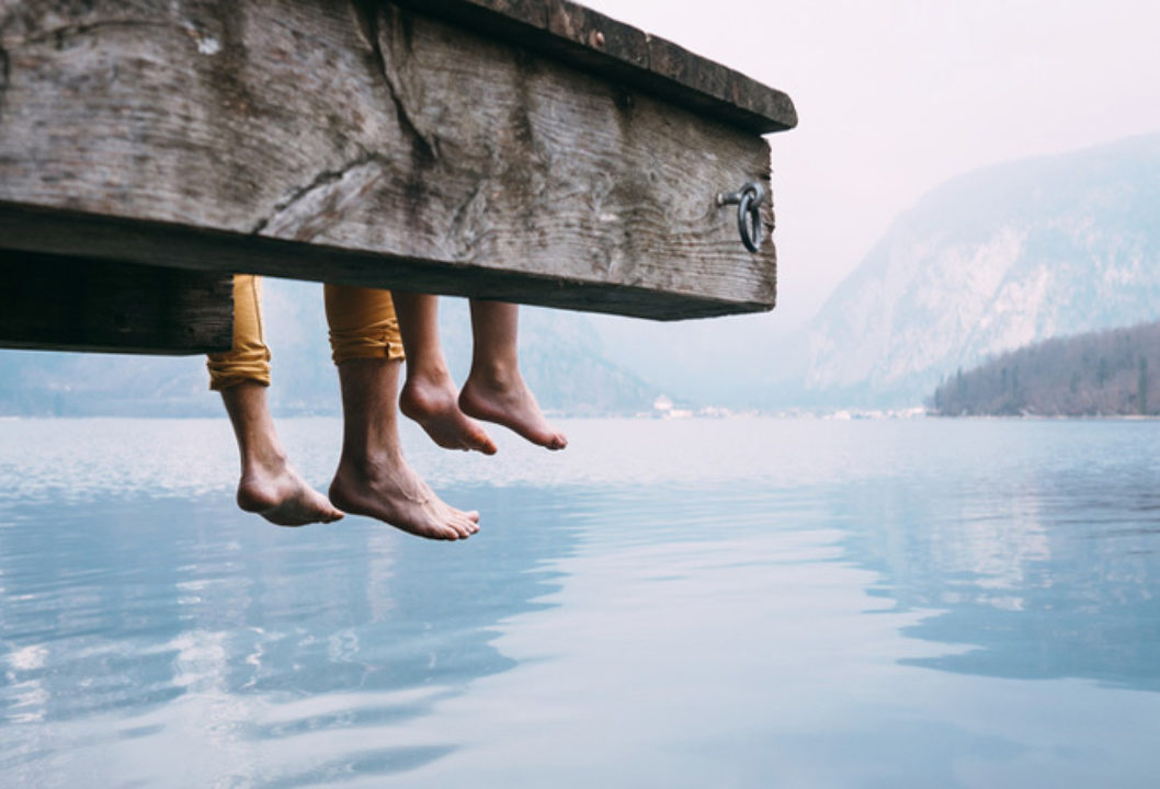 father and son hanging feet