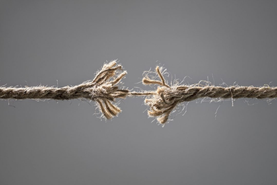 fraying rope about to break symbolizing burnout