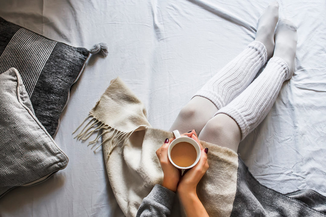 Woman on bed with cocoa