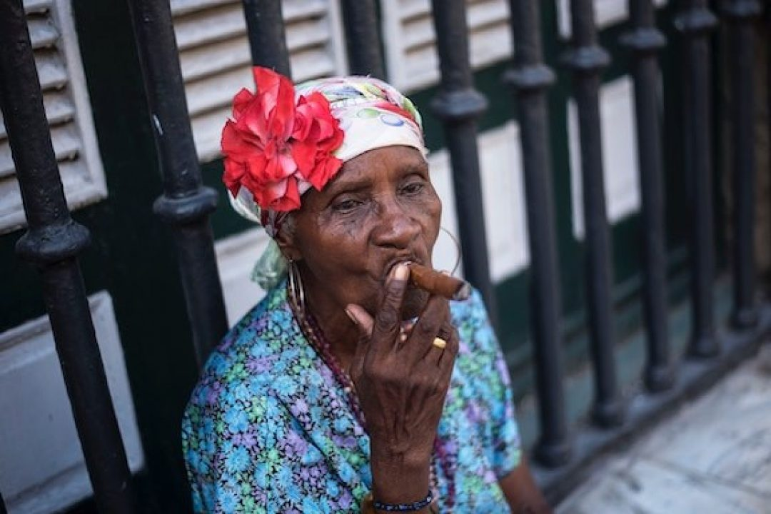 Woman smoking cigar hoodoo meaning