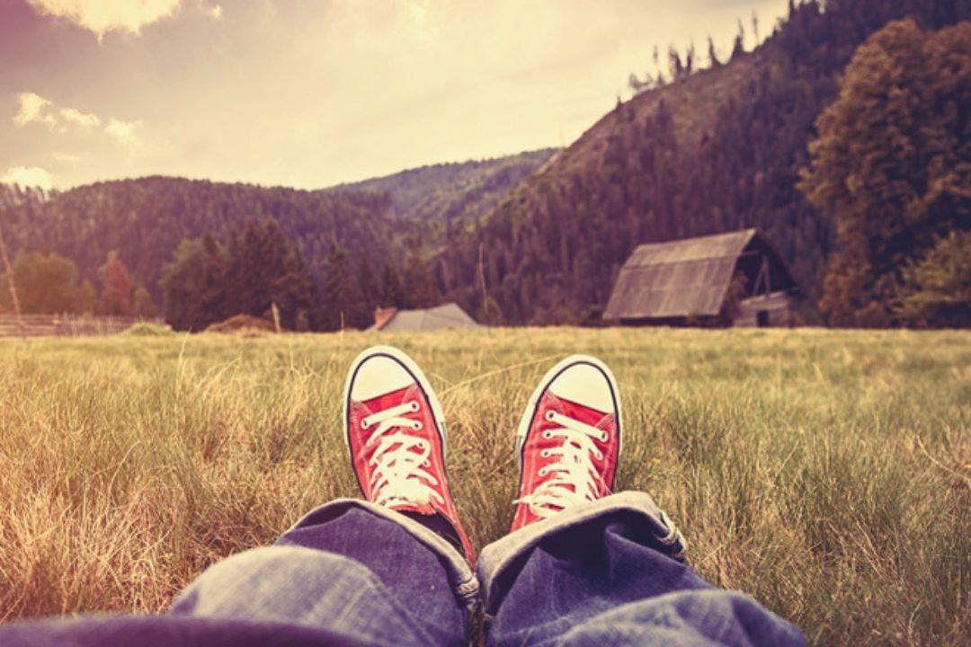 Boy relaxing in grass
