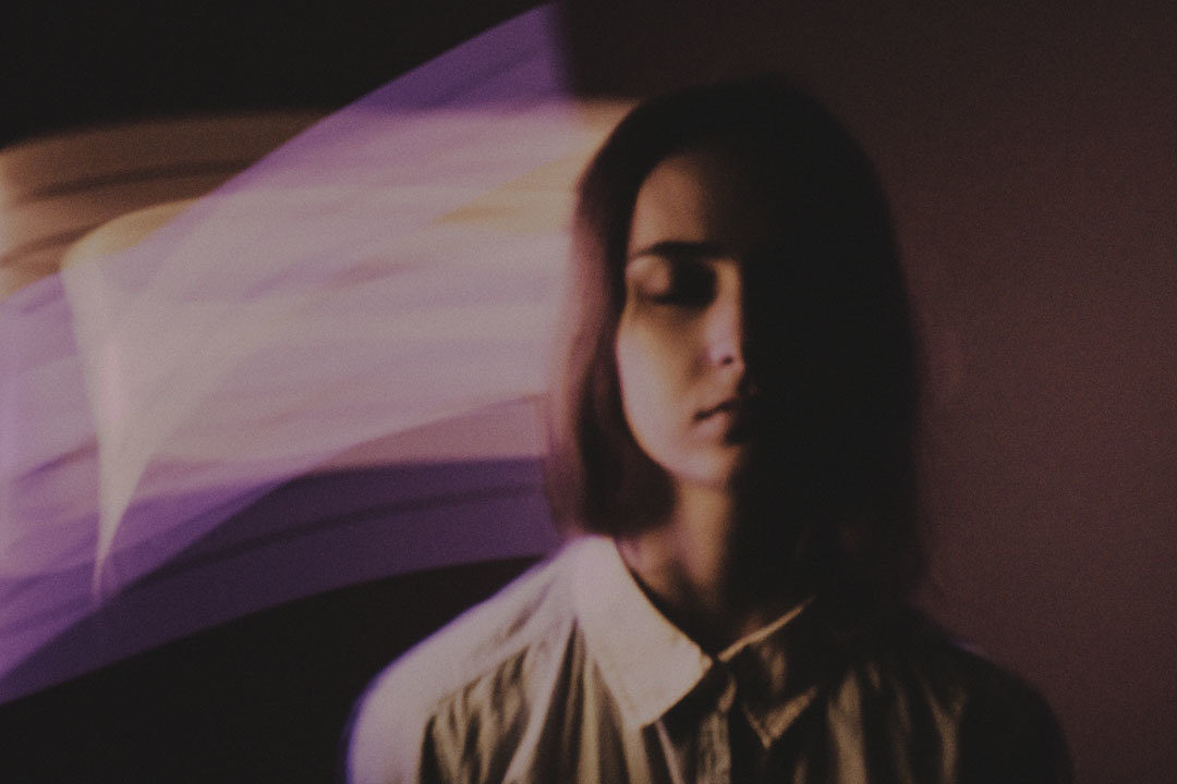 Girl with multi-colored light