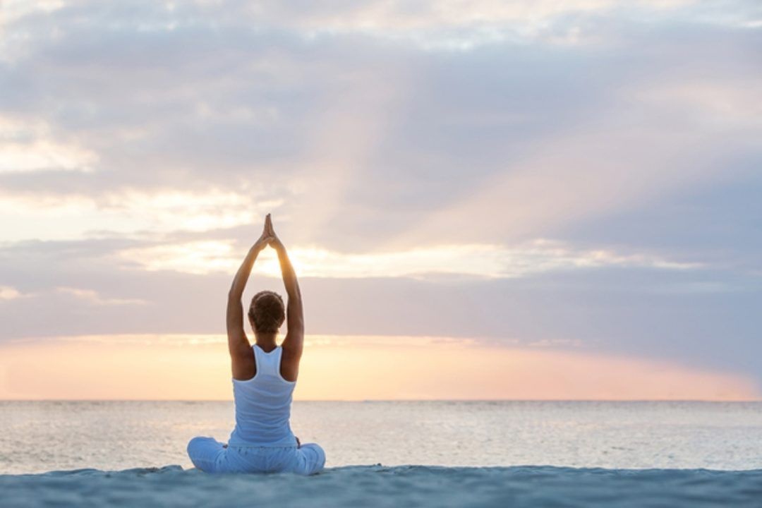 Woman doing yoga on the water