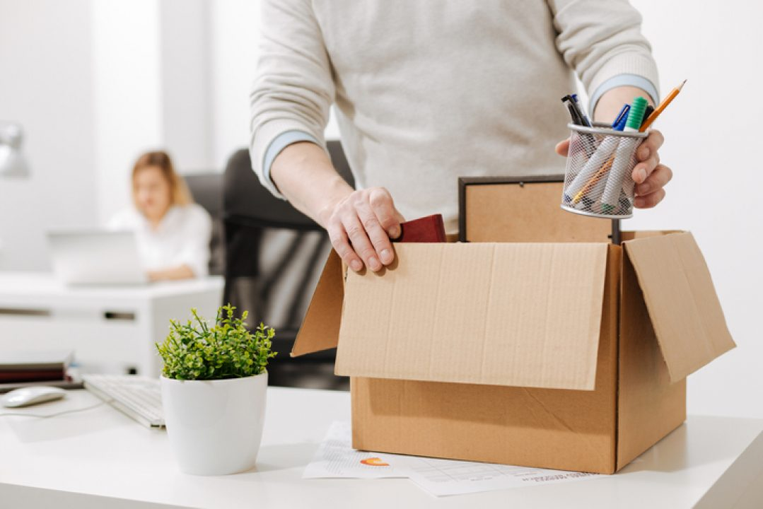 person packing box quitting job