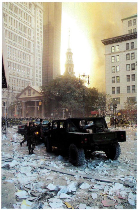 Fires burn behind St. Paul's Chapel where the World Trade Center stood.