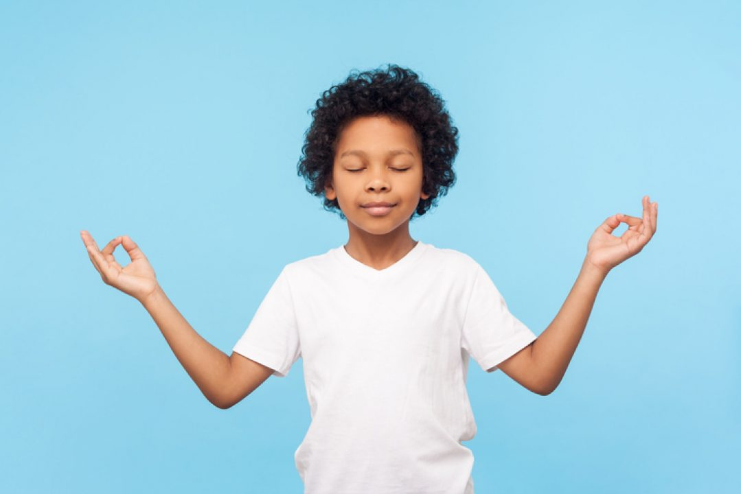 Teaching mindfulness to kids boy in meditation